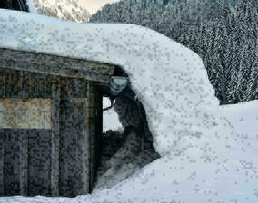 Snow-covered hut roof