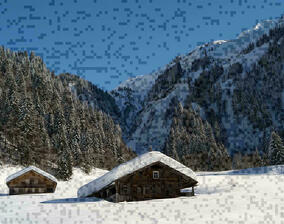 Snow-covered countryside with huts